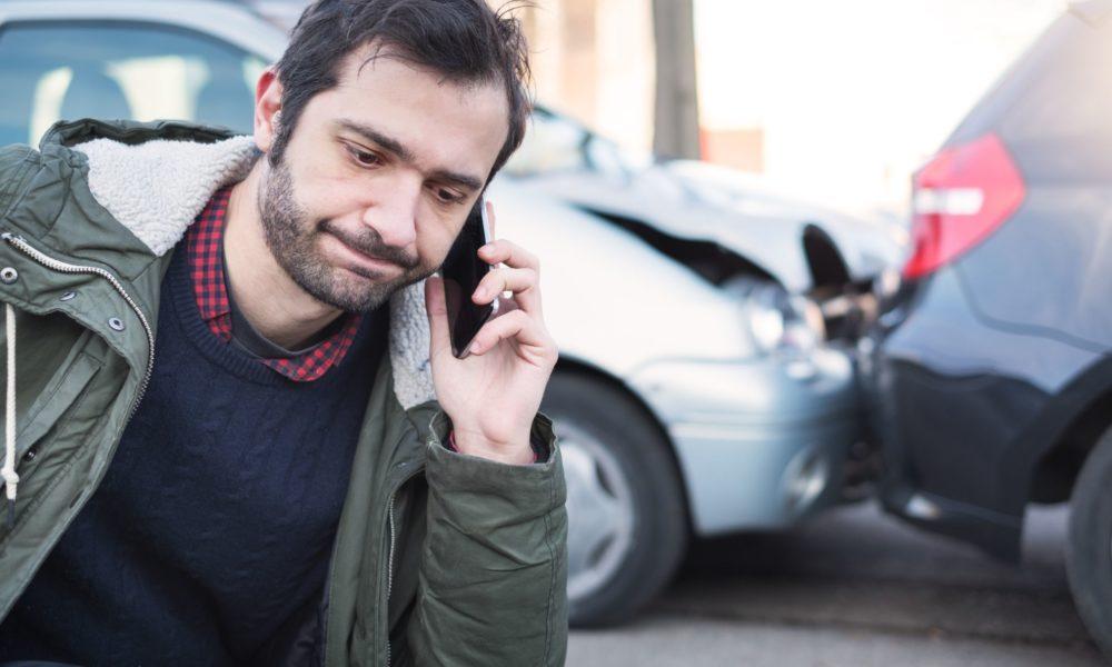 Man making a call about a car crash